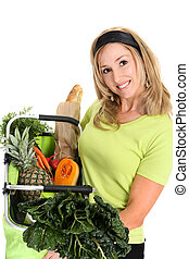 Woman displaying bag full of groceries - Fresh Healthy...