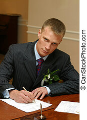 Contract - The groom signs the contract