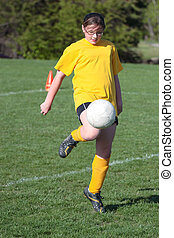 Girl on Soccer Field 21 - Girl on Soccer field kicking ball...