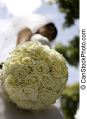 Brides bouquet - Traditionally dressed bride with veil...