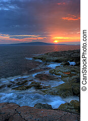 Sunset in Acadia National Park - Sun sets along the Maine...