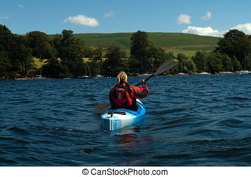 Kayaking on Lake Windermere - Female kayaker on Lake...