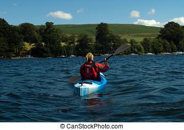 Kayaking on Lake Windermere - Female kayaker on Lake...