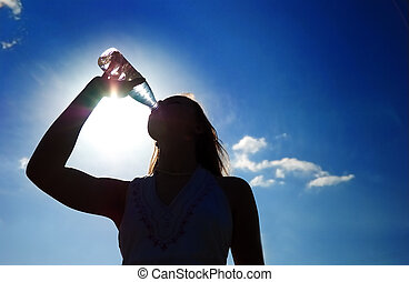 silhouette of girl drinking water outdoor