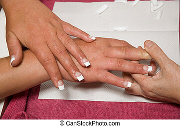 Manicurist installing nails - Manicurist installing fake...