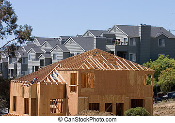 House under construction - A large modern wood framed house...