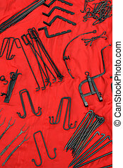 Wrought iron tools - Old-fashioned wrought iron tools on red...