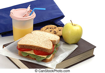 School Lunch - School lunch of sandwich, juice and snacks on...