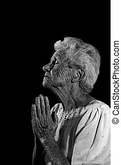 God, Are you listening - Very Old Woman Praying to the Lord