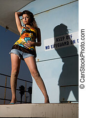 Woman on lifeguard stand - Attractive woman standing on a...