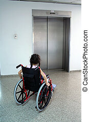 girl on wheelchair - Young girl on wheelchair waiting for...