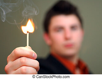 Young Man w/Flaring Match - Young man holding a flaring...