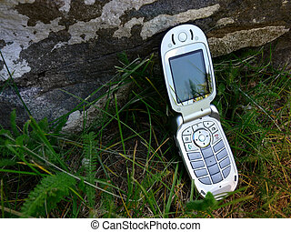 Nature Calls - Cell phone leaning against a rock in the...