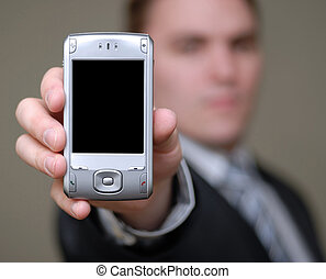 Businessman Shows Cell Phone with Shallow Depth of Field -...