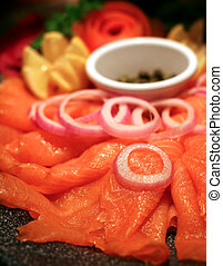 Smoked Salmon Platter - A platter of smoked salmon with...