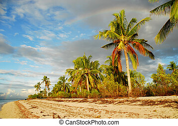 Tropical beach with rainbow - Tropical exotic pristine Asian...
