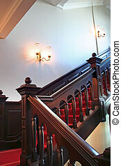 Stairways - Wooden stairways with dark wood railings white...