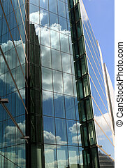 Corporate glass buildings in city centre with blue sky