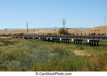 Trestle - Railroad trestle across overgrown river, Alviso,...
