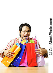 Shopping - An isolated shot of a happy young man with...