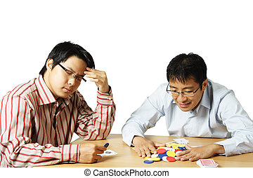 Playing poker - An isolated shot of two young men playing...