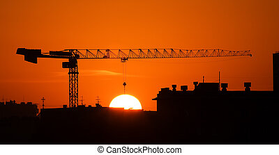 Crane and the sun - The elevating crane with a long arrow on...