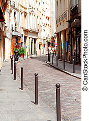 Paris street - Small street with cobblestone pavement in...