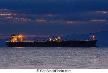 Ship at dusk - Image of an illuminated merchant ship at dusk