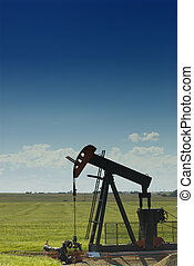 pumpjack - a pumpjack lifting natural gas out of the ground...