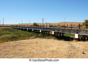 Trestle - Railroad trestle across overgrown creek, Alviso,...