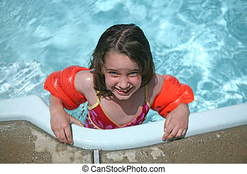 Lets Go Swimming - Young Child in Swimming Pool Water