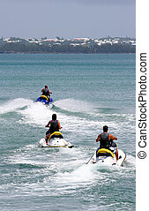 Jet Skiers - Jet skiers speeding out across the bay