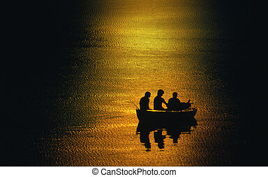 rowing boat with people in the sundown