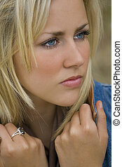Distant Beauty - Close up portrait of a beautiful young...