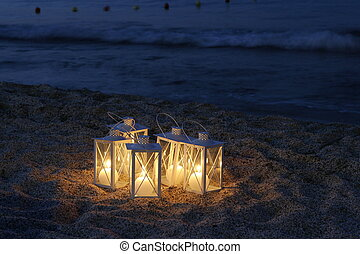 Candle light - a candle light by the sea in a tourist resort...