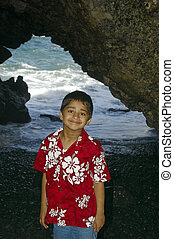 Happy Indian Kid - Happy Indian kid at a cave in a tropical...