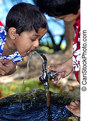 Drinking Water - An Elder brother helpiong younger brother...