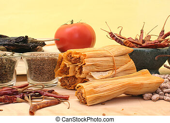 Mexican Food - Tamales with Peppers and Beans on Yellow...
