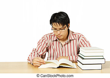 Reading books - An isolated shot of a young man reading...