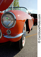 Red Corvette - Close-up of front end and headlight of a...
