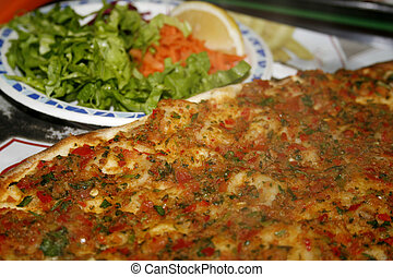 Lahmacun Turkish food - Pancake with spicy meat filling