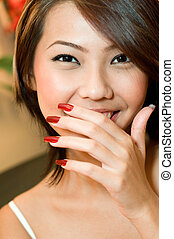 Girl and Nails - A young attractive Asian woman with freshly...