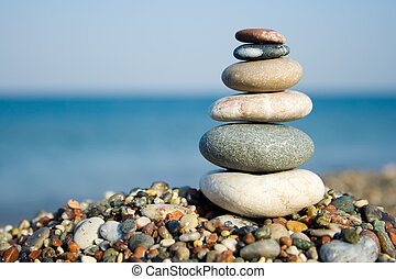 Stacked pebbles - Differently sized and colored pebbles,...