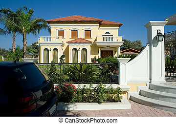 Luxury home and a car in the front of the house