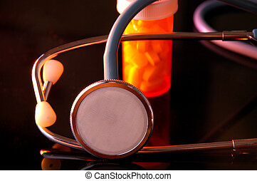 Stethoscope and Pill Bottle with reflections in table top...