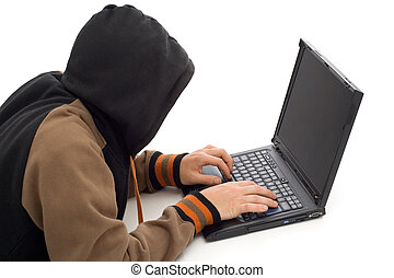 The hacker - Hacker in the front of a laptop computer