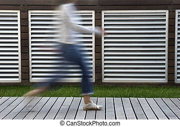 Woman walking - A motion blur abstract of a person walking...