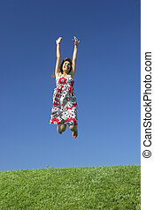 Carefree Lifestyle - Happy woman on a beautiful green meadow