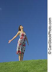 Free time - Happy woman having fun on a beautiful green...