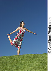 Free time - Happy woman having fun on a beautiful green...